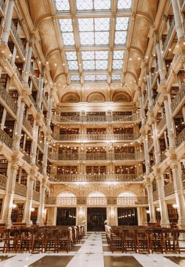 Beautiful wedding at the Peabody Library in Baltimore.  Florals by Lynn Jeunette.  Photos by KateAnn Photography.   http...