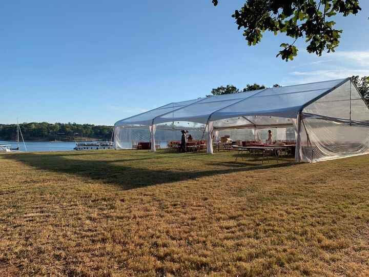 """Beautiful 50'X 60' Clear Span transparent tent with """" Father-of-Bride"""" lighting package."""